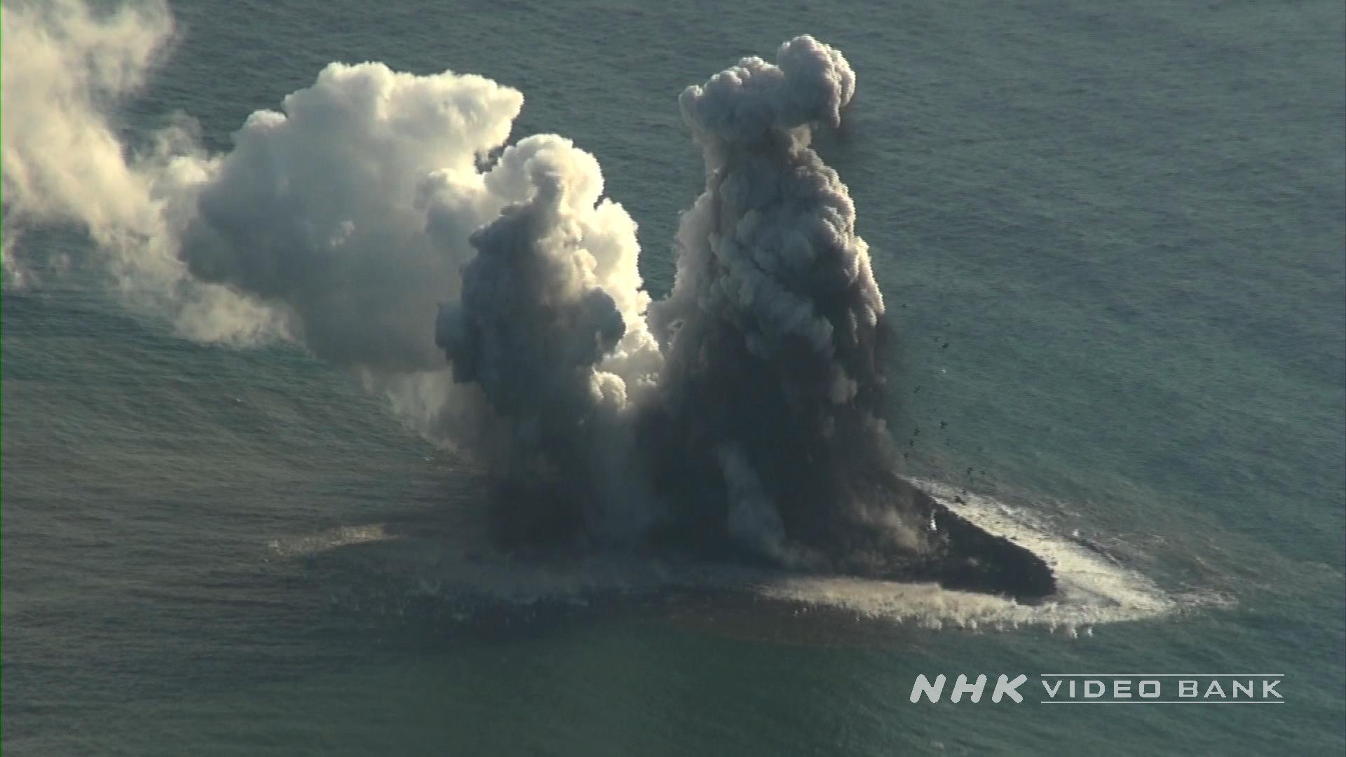 Aerial: Nishinoshima volcano erupting moment