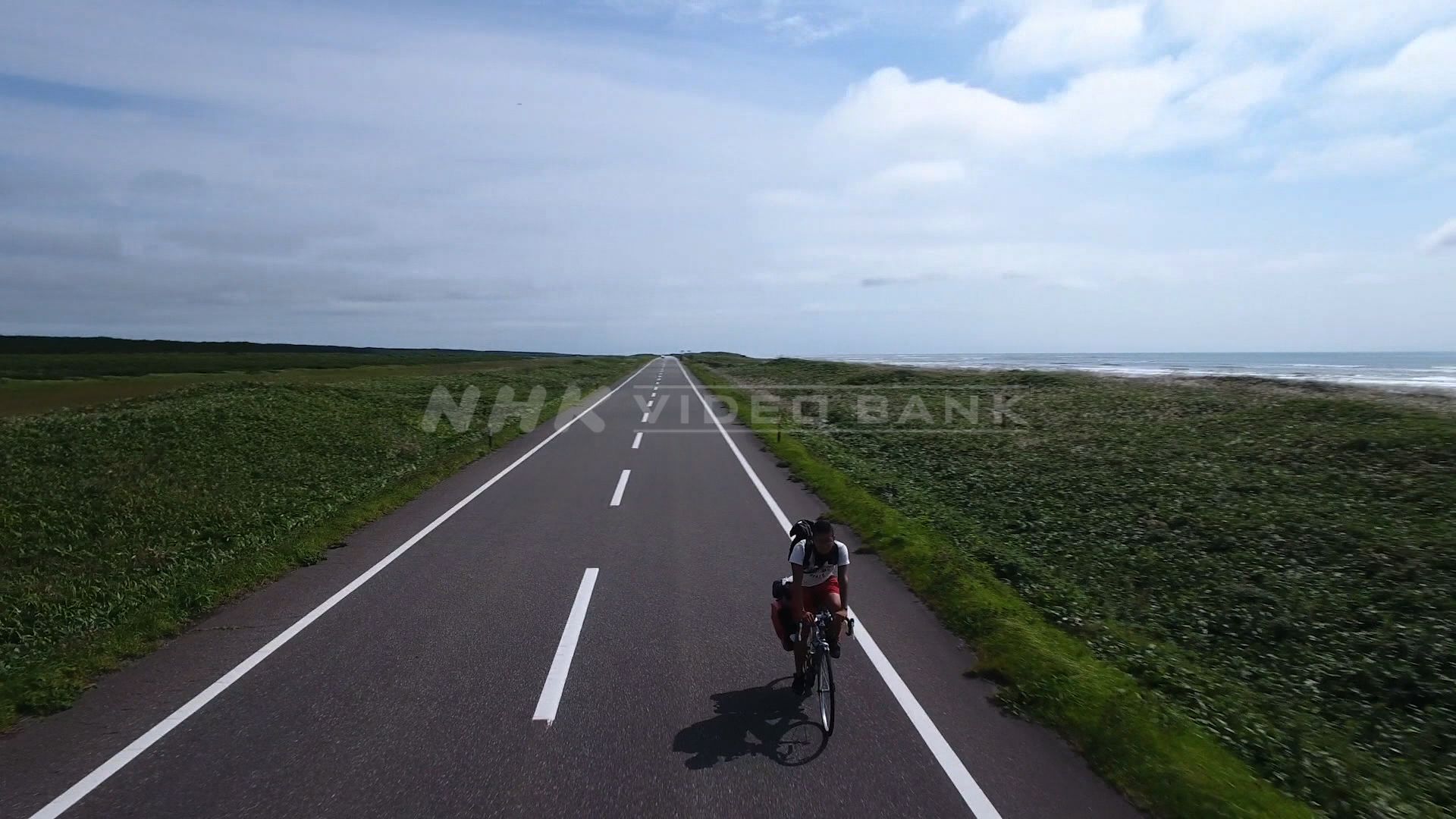 Drone shot:  Road bicycle on the Japan Sea Ororon Line, Hokkaido, northern Japan